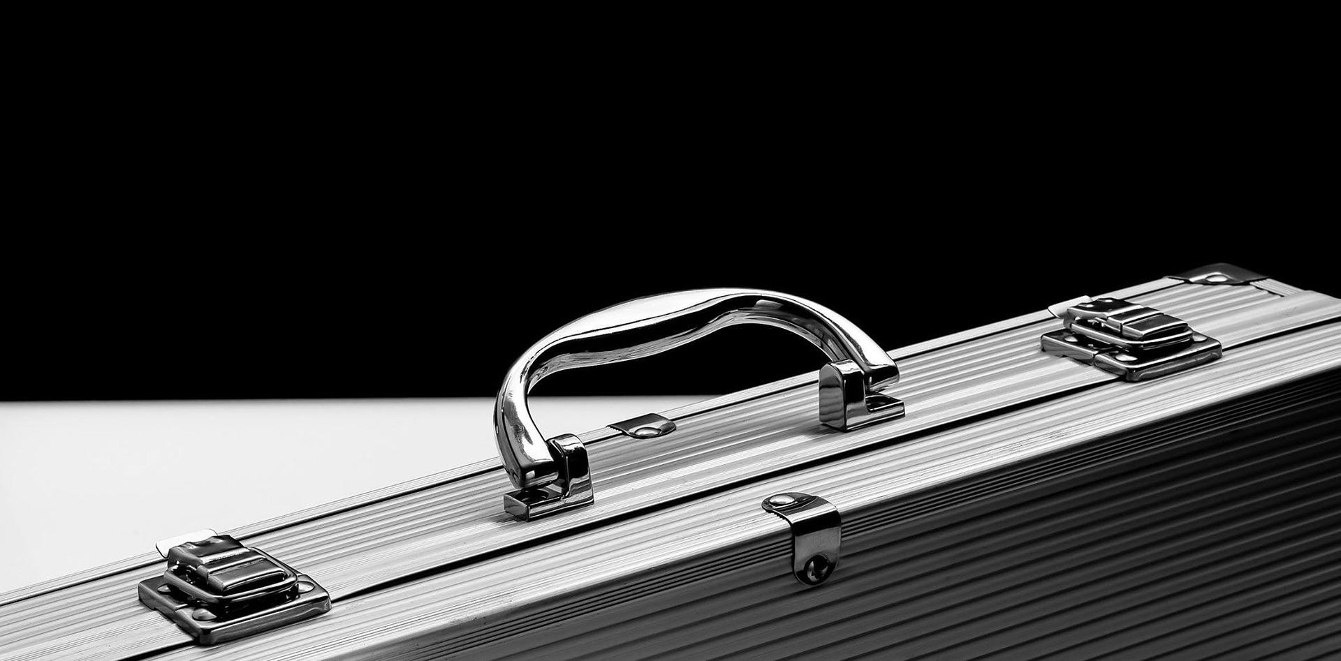 Silver Briefcase against black background
